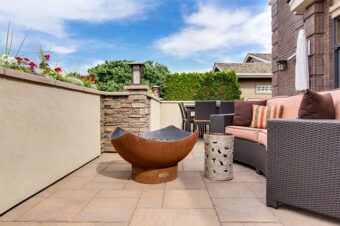 a fire pit on a patio, with furniture