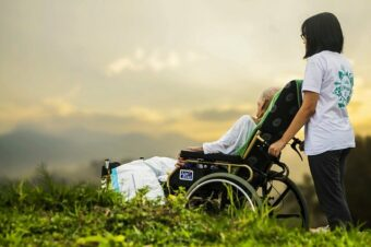 how-to-take-care-of-the-elderly-at-home: woman with person in wheelchair