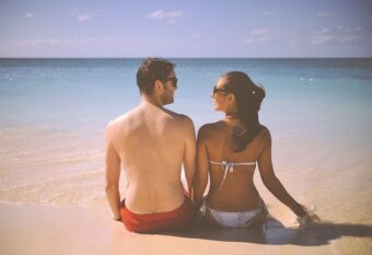 home-lase- hair-removal: couple in swim suits on beach